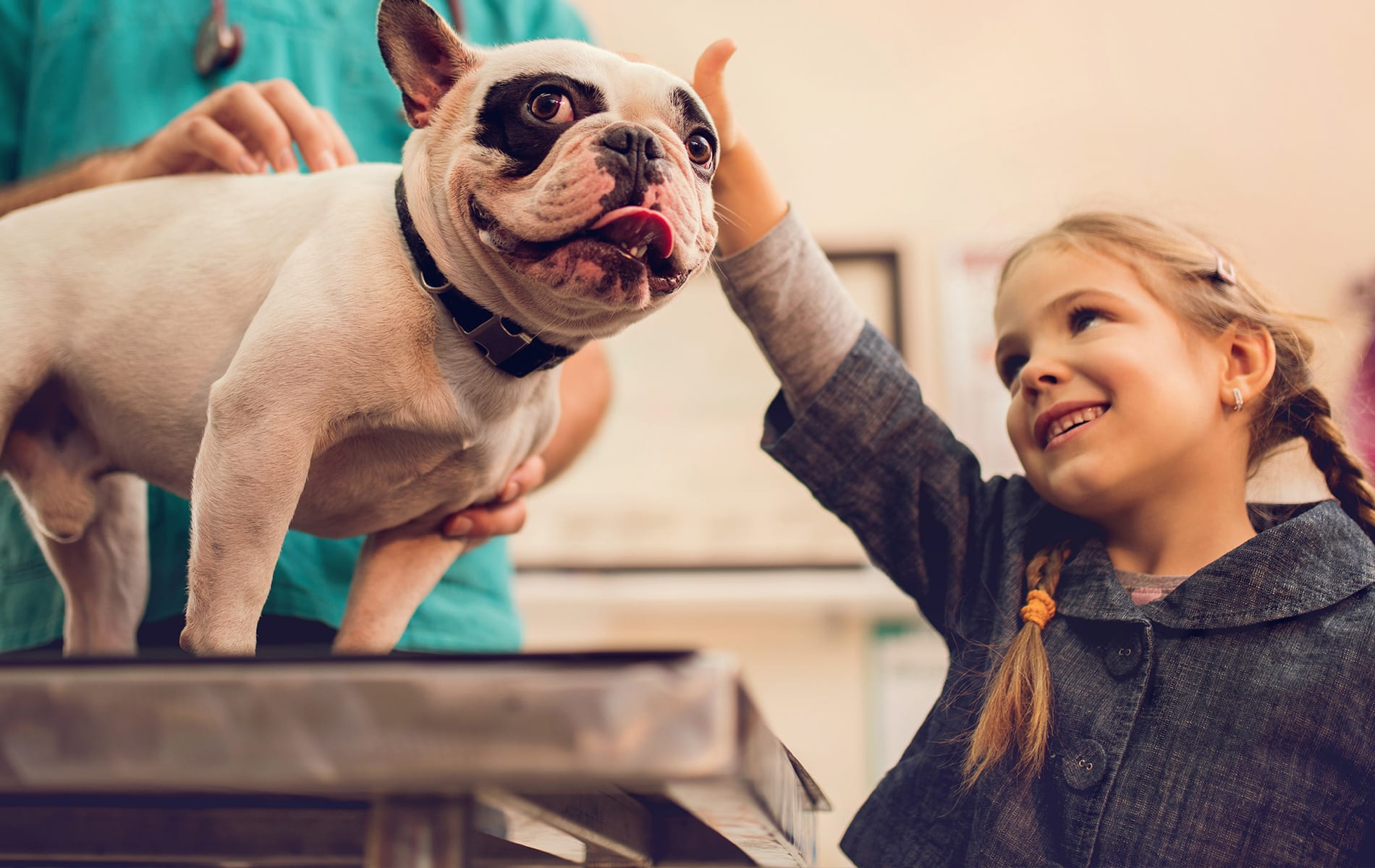 girl-with-her-dog-at-the-vet